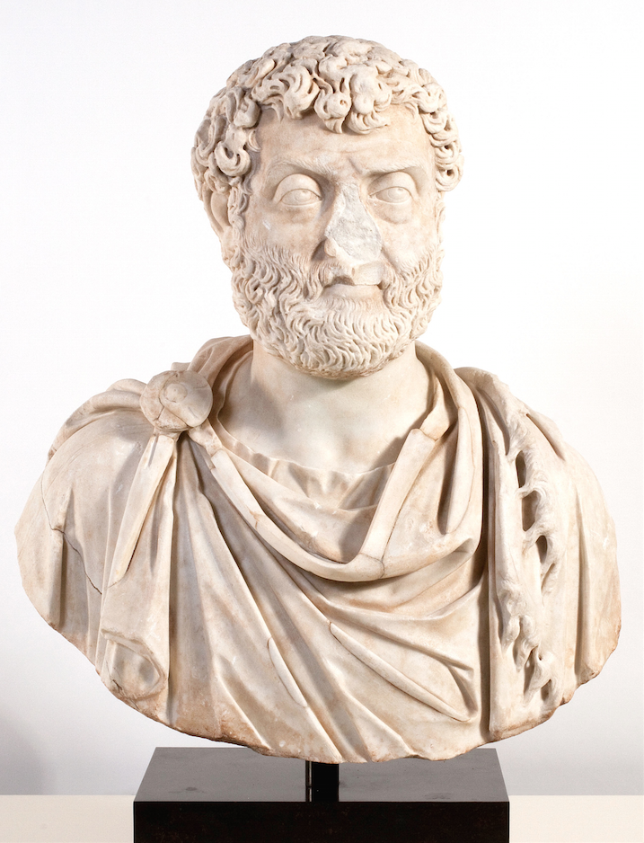 Image of a Roman bust of a man with a beard with his nose broken off